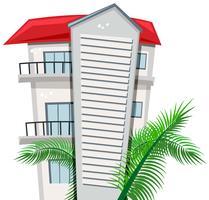Appartementengebouw en palmbladeren