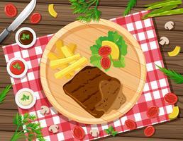 Biefstuk met friet en salade op het bord