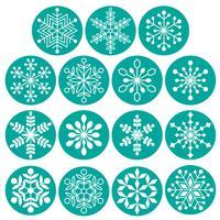 witte sneeuwvlokken op turquoise blauwe cirkels