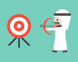 Arabische zakenman tekening boog naar schieten doel, platte ontwerp bedrijfssituatie vector