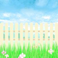 Tuinieren hek een achtertuin met blauwe hemel.