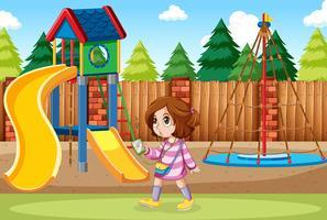 Een meisje dat aan muziek bij het park luistert vector
