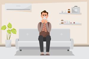 zieke man met een koude en stromende neus in de kamer