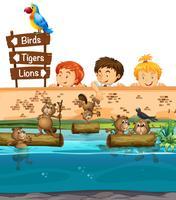 Kinderen loochen naar bevers in de dierentuin vector