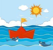 Oranje paperboat die in de oceaan drijft