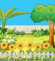 Scène met bomen en bloemen in de achtertuin