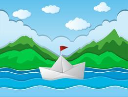 Papierboot die langs rivier drijft