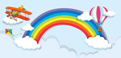 Vliegtuig en ballon over de regenboog