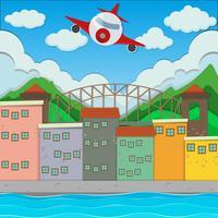 Vliegtuig die over de stad vliegen