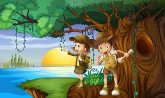 Twee kinderen kamperen aan de rivier vector