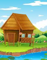 Houten hut langs de rivier