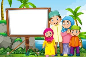 Moslimfamilie in het park