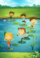 Kinderen die op lotusbloembladeren stappen vector