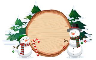 Een sneeuwman op houten banner