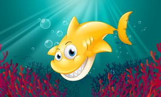 Een gele haai die onder het overzees glimlacht vector