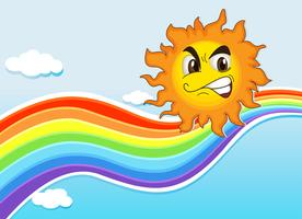Een hemel met een regenboog en een boze zon