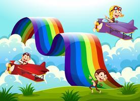 Een rood en een violet vlak met apen die dichtbij de regenboog vliegen