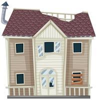 Geruïneerd huis met gebroken dak en raam
