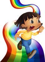 Een regenboog met een kind dat speelt
