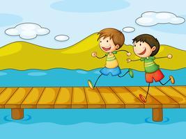 Jonge jongens die bij de brug spelen
