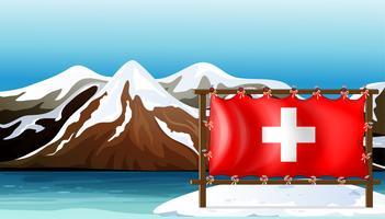 De vlag van Zwitserland aan de zee