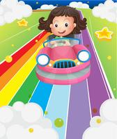 Een klein meisje die in een roze auto berijden