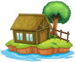 Een huis en een boom op het eiland