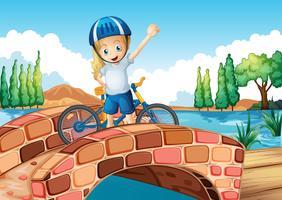 Een vrouwelijke fietser die zich boven de brug bevindt