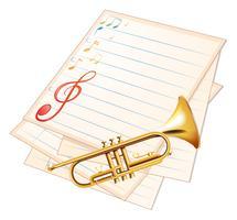 Een leeg muziekpapier met een trompet