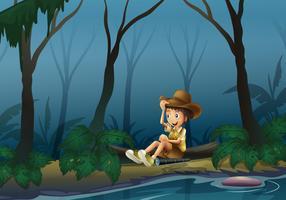 Een mannelijke ontdekkingsreiziger ontspannen in de buurt van de rivieroever