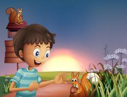 Een jonge jongen verbaasd over de eekhoorn