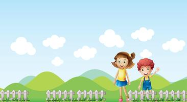 Een meisje en een jongen in een berglandschap