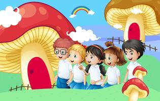 Vijf studenten in de buurt van de gigantische paddestoelhuizen