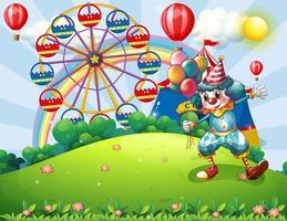 Een clown op de heuveltop met een pretpark en een regenboog