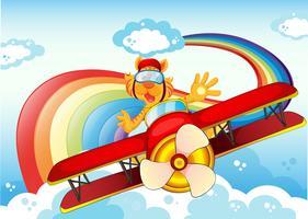 Een tijger op een vliegtuig dichtbij de regenboog