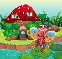 Een reusachtig paddestoelhuis dichtbij de rivier met een vlinder