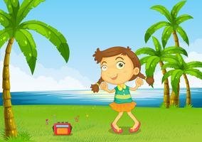 Een schattig klein meisje dansen in de buurt van de rivier