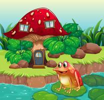 Een reusachtig paddestoelhuis dichtbij de rivier met een kikker