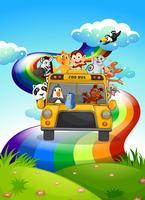 Een dierentuinbus die door de regenboogweg reist vector