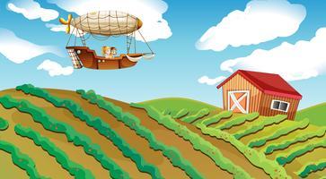Een luchtschip dat over een boerderij passeert