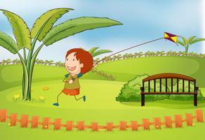 Een jongen die vlieger speelt