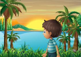 Een rivieroever met een jonge jongen