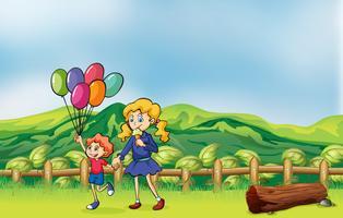 Een gelukkig kind met ballonnen en een meisje het eten van een ijsje
