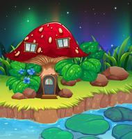 Een rood paddestoelhuis dichtbij de rivier met waterlilies