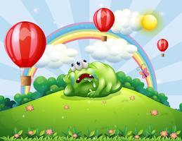Een vermoeide monster boven de heuvel kijkt naar de heteluchtballonnen vector