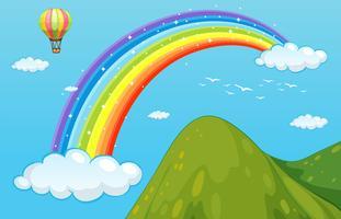 Regenboog en berg