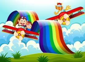 Speelse dieren in de buurt van de regenboog boven de heuvels vector