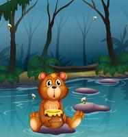 Een beer zit op een steen met een pot honing