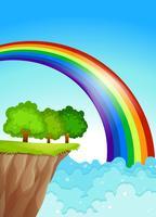 Een prachtige regenboog aan de hemel vector
