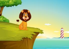 Een leeuw zit op de klif met uitzicht op de toren